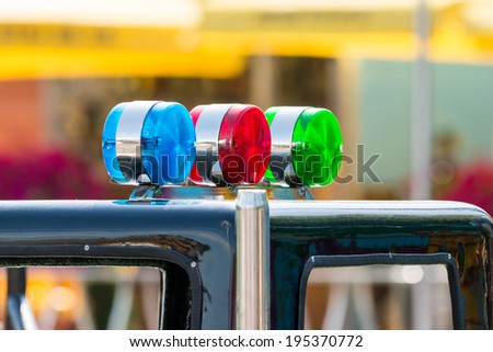 Blue, Red And Green Sirens On Car Top - stock photo
