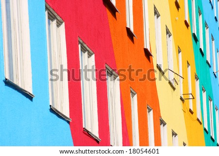 Blue, red, green, orange homes - stock photo