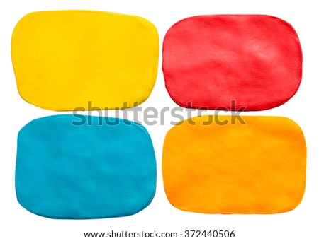 Blue, red, yellow and orange plasticine texture isolated on white background - stock photo