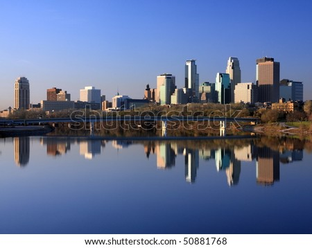 Blue reflection of Minneapolis in Mississippi - stock photo
