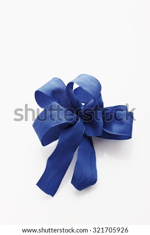 Blue ribbon on white background