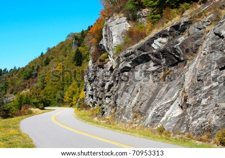 Blue Ridge Parkway road and rock wall - stock photo