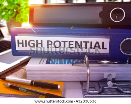 Blue Ring Binder with Inscription High Potential on Background of Working Table with Office Supplies and Laptop. High Potential Business Concept on Blurred Background. 3D Render. - stock photo