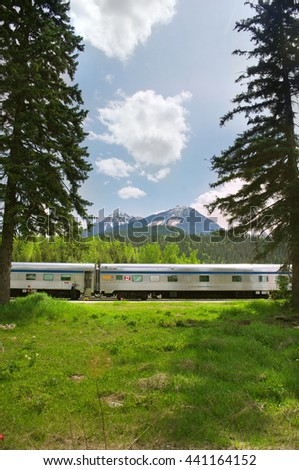 Blue River , British Columbia , Canada 4 June 2012 Railway train stop-over for passenger boarding and disembarkation  in the Canadian Rockies station of Via-Rail Canadian National Rail. - stock photo