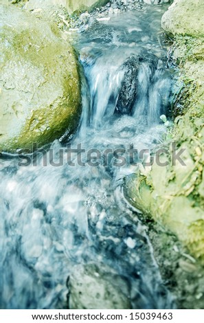 blue river through rocks - stock photo