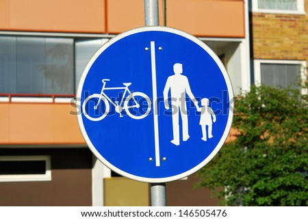 Blue road sign for bicycle and pedestrian traffic