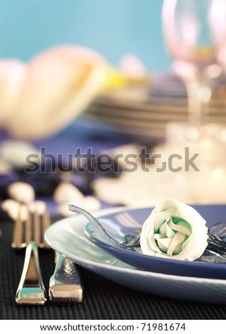 Blue romantic table setting - stock photo
