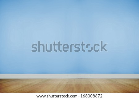 Blue room with wooden floor - stock photo