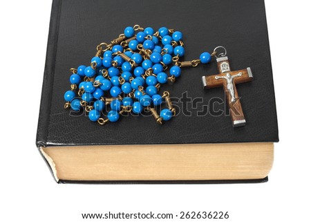 Blue rosary and black holy bible isolated on white background. - stock photo