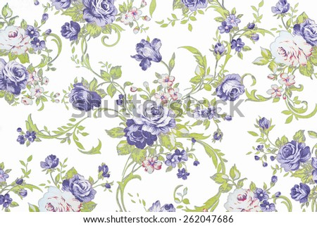 blue rose on white fabric background, Fragment of colorful retro tapestry textile pattern with floral ornament useful as background. - stock photo