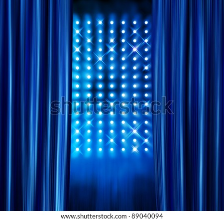 Blue satin curtains reveal stage spotlight lamps wall background