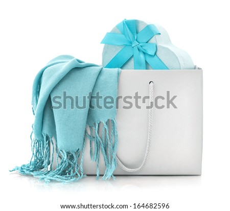 Blue scarf in shopping bag with gift box isolated on a white background - stock photo