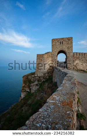 Blue sea and an ancient Kaliakra fortress on the Black see coast in Bulgaria, Europe. - stock photo