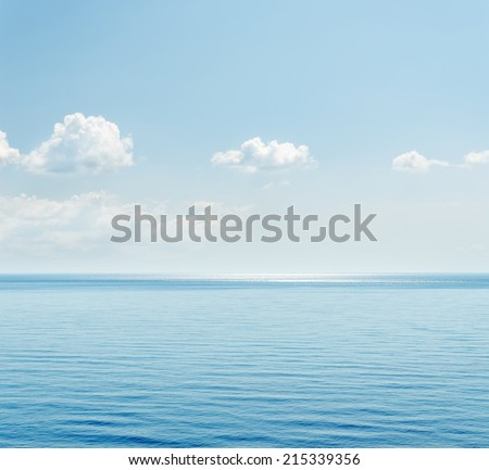blue sea and clouds over it - stock photo