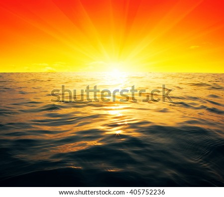 Blue sea and sun on sunset - stock photo