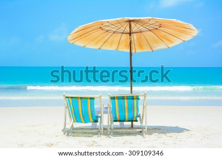 Blue sea and white sand beach with beach chairs and umbrella, Samed island, Thailand - summer holiday and vacation concepts - stock photo