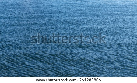 Blue sea surface for background. Selective focus on foreground. - stock photo