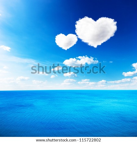 Blue sea under clouds sky with heart shape cloud background - stock photo