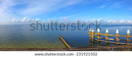 Blue sea water harbor exit panoramic landscape. Pastoral Dutch seascape. Netherlands - stock photo