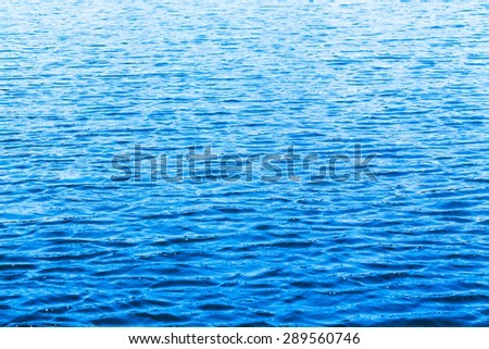 blue sea water surface background. - stock photo