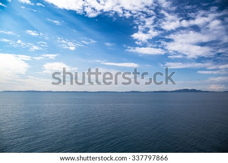 Blue sea waters and blue sky with clouds horizon - stock photo