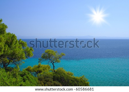 Blue sea with green trees on the beach in Croatia - stock photo