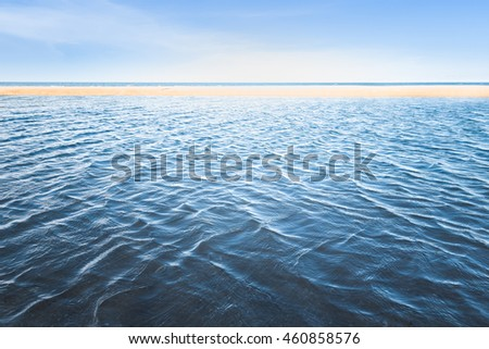 Blue sea with nice calm wave on the beach under sunlight  in Thailand, Sea and beach for background, Texture of wave in the sea
