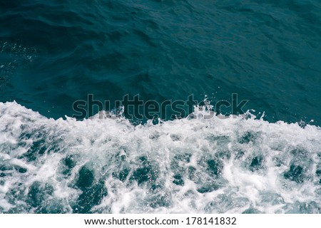 Blue sea with waves and foam - stock photo