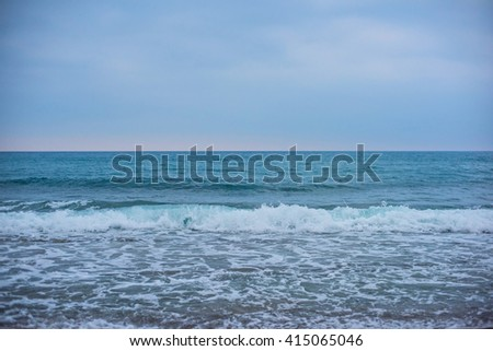 Blue sea with waves and sky - stock photo