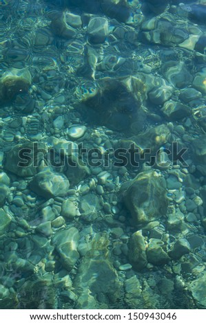 blue seabed at sunny day background - stock photo