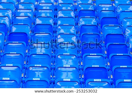 Blue seat in the stadium. - stock photo