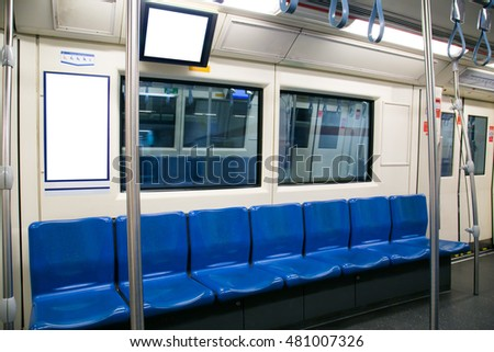 Blue seats and grab bars in electric trains