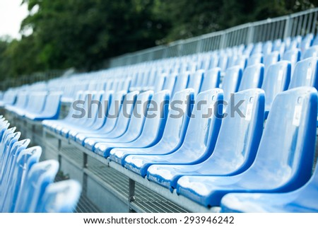 blue seats in linear perspective - stock photo