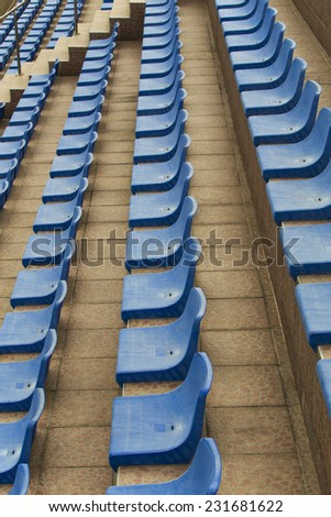 Blue seats on stadium - stock photo