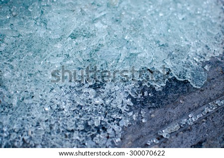 Blue shattered glass close up on the floor - stock photo