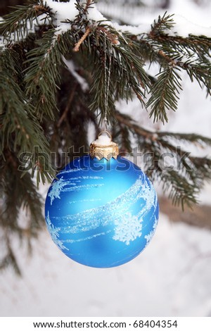 Blue shining ball on a fir-tree at a winter forest - stock photo