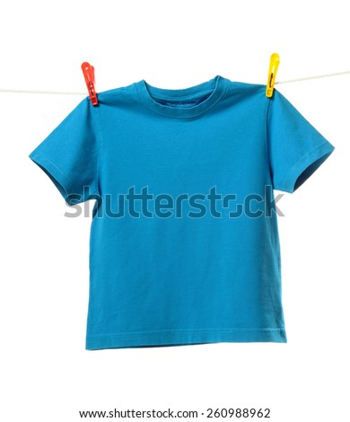 Blue shirt hanging on the clothesline. Image isolated on white background   - stock photo