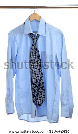 blue shirt with tie on wooden hanger isolated on white - stock photo