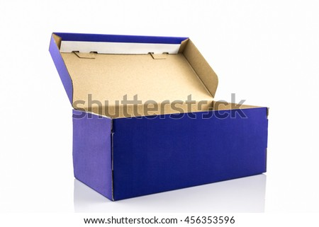 Blue shoe box with clipping path on white background. Paper box for shoes, electronic device and other products.