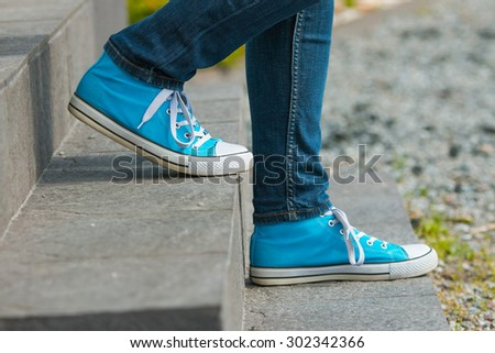 Blue shoes stone stairs take steps in Finland.  - stock photo