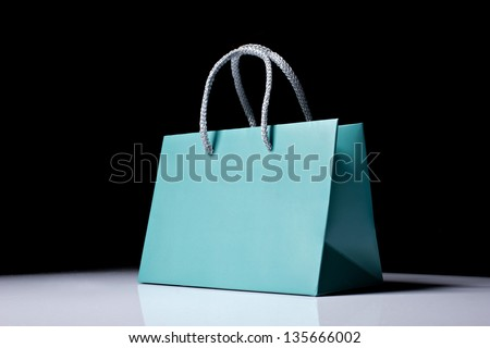 blue shopping bag on white-black background - stock photo