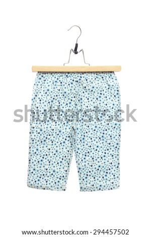 Blue Shorts flower and heart pattern texture baby clothes in clothes hanger, isolated on white background. - stock photo