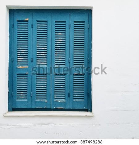Blue shutter on white background - stock photo