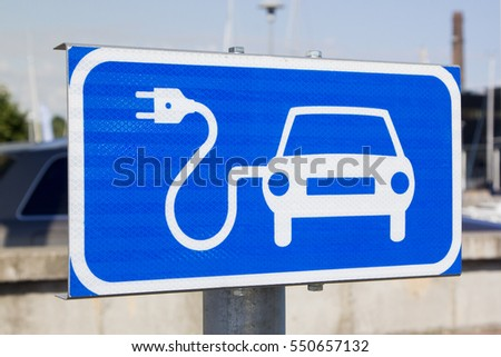 Blue sign indicating a charging point for electric vehicles