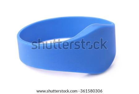Blue silicone RFID bracelet isolated on white - stock photo
