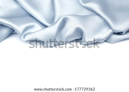 Blue silk isolated on white background - stock photo