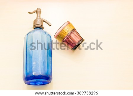 Blue siphon with red glass - stock photo