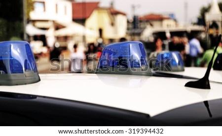 Blue sirens of police car while patrolling in the city