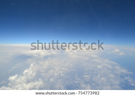 Blue skies and wihte clouds on airplane view