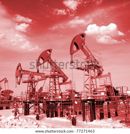 Blue sky above oil field. Red filter - stock photo